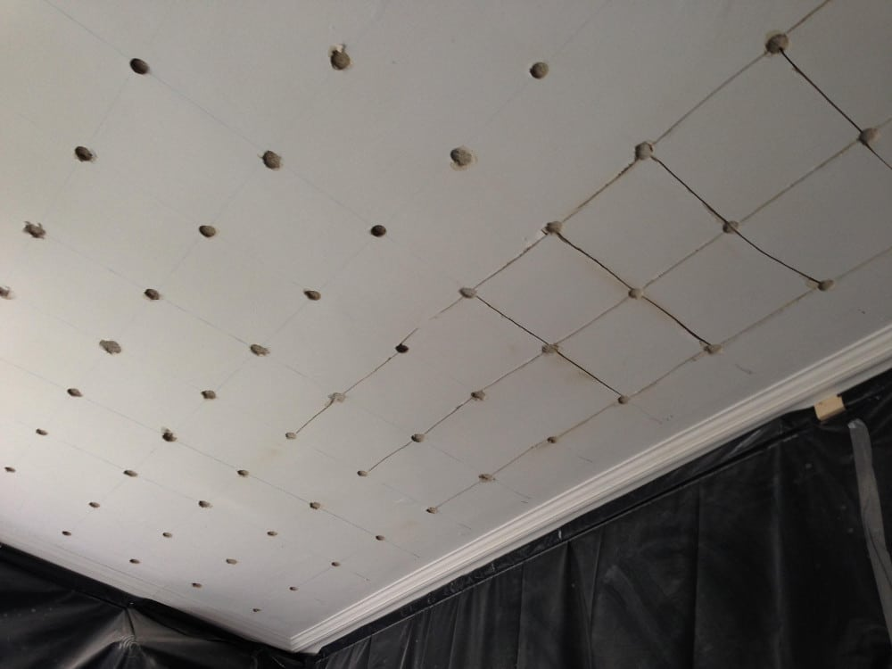 Consolidating Ceiling Using wire washer method from below